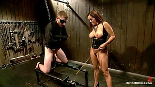 dominatrix with nice tits plays with her slave