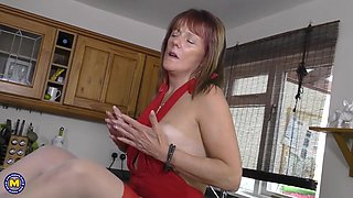 lustful granny pandora plays with a dildo in the kitchen