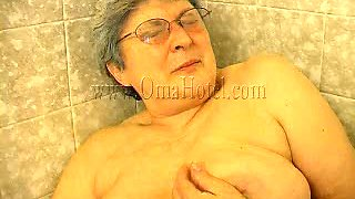 Fat old whore in the bathroom masturbates with anal beads