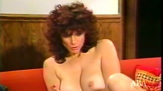 Delightful busty auburn haired milf majestically rides a dick