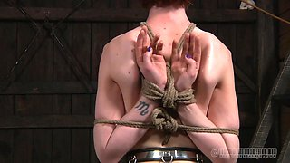Horny bondage master puts his slave in extreme reverse prayer position