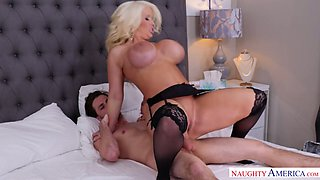 Giant breasted blonde housewife Alura Jenson is happy to ride stiff dick