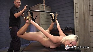 Flexible blonde slave gets huge dick in bondage