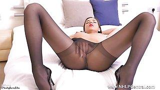 Cute brunette masturbates wet pussy in black pantyhose