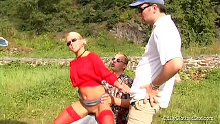 Charming broads giving wild blowjobs before being throbbed in an outdoors orgy