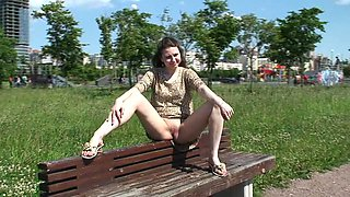 Cute plump teen Masha flashes her muff sitting on the bench in suburb