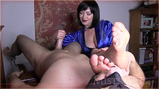 Perverted mature babe hand and foot jerks her slave