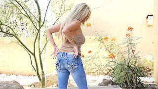 Perfect blonde takes off jeans and masturbates on a bench