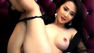Sensuous Asian beauty exposes her curves and her juicy holes